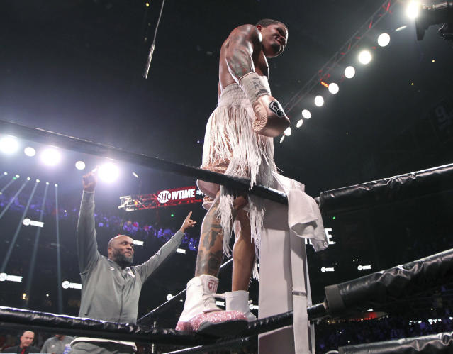Gervonta Davis stands on the ropes after defeating Yuriorkis Gamboa, not seen, for the WBA secondary lightweight boxing title early Sunday, Dec. 29, 2019, in Atlanta. (AP Photo/Tami Chappell)