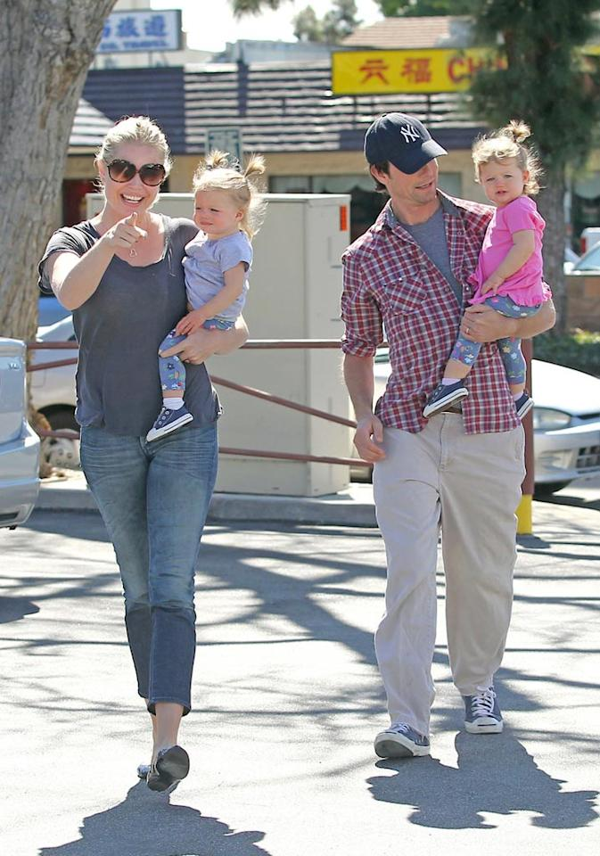 """Rebecca Romijn and Jerry O'Connell were spotted taking their adorable fraternal twin daughters Dolly and Charlie out for a family lunch in Los Angeles on Sunday. Sam Sharma/<a href=""""http://www.pacificcoastnews.com/"""" target=""""new"""">PacificCoastNews.com</a> - March 14, 2010"""