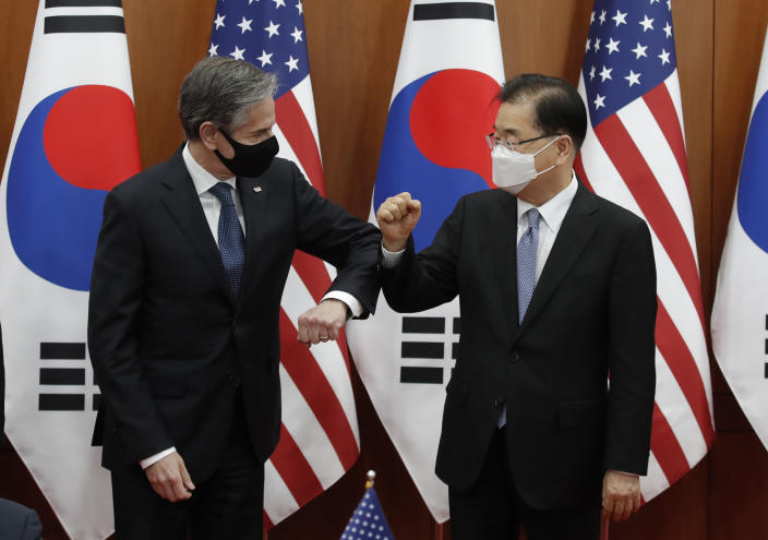 U.S. Secretary of State Antony Blinken, left, bump elbows with South Korean Foreign Minister Chung Eui-yong after an initialing ceremony for Special Measures Agreement at the Foreign Ministry in Seoul, South Korea, Thursday, March 18, 2021. (AP Photo/Lee Jin-man, Pool)