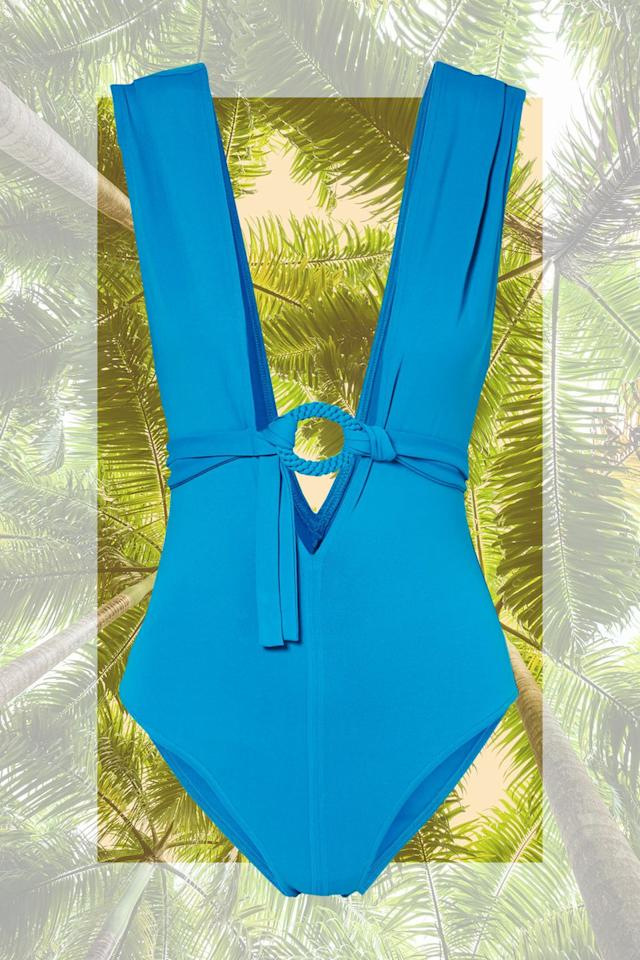 """<p><em>Eres Studio Spray Belted Swimsuit<br></em><a rel=""""nofollow"""" href=""""https://www.net-a-porter.com/us/en/product/1012997/eres/studio-spray-belted-swimsuit"""">SHOP NOW</a> $540</p><p>When it comes to choosing swimwear for a trip, variety is key. My rule of thumb: <strong>Pack one suit with a pattern, one brightly colored solid, and a classic black bikini or one-piece.</strong> The solid will be your most important staple, no matter where you're going. I like to think of mine as a <strong>blank canvas that functions as the backdrop for printed coverups</strong> or bold jewelry.</p>"""