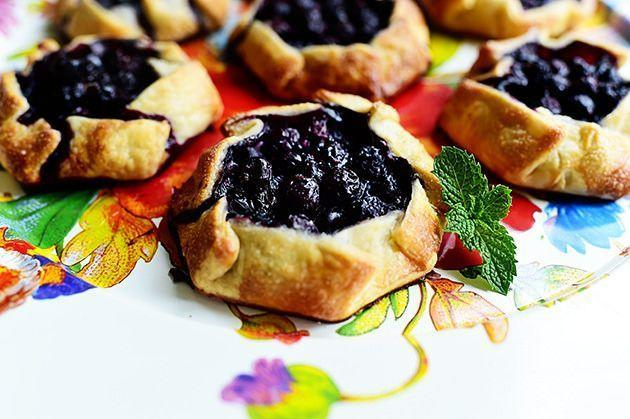 """<p>A galette is basically a flattened-out version of pie—just slightly more rustic-looking—so you don't have to worry about making the edges perfectly crimped. Fill them with blueberries for an easy summer dessert. </p><p><a href=""""https://www.thepioneerwoman.com/food-cooking/recipes/a11779/mini-blueberry-galettes/"""" rel=""""nofollow noopener"""" target=""""_blank"""" data-ylk=""""slk:Get Ree's recipe."""" class=""""link rapid-noclick-resp""""><strong>Get Ree's recipe. </strong></a></p><p><a class=""""link rapid-noclick-resp"""" href=""""https://go.redirectingat.com?id=74968X1596630&url=https%3A%2F%2Fwww.walmart.com%2Fsearch%2F%3Fquery%3Dpastry%2Bcutter&sref=https%3A%2F%2Fwww.thepioneerwoman.com%2Ffood-cooking%2Fmeals-menus%2Fg36558208%2Fsummer-pie-recipes%2F"""" rel=""""nofollow noopener"""" target=""""_blank"""" data-ylk=""""slk:SHOP PASTRY CUTTERS"""">SHOP PASTRY CUTTERS</a></p>"""