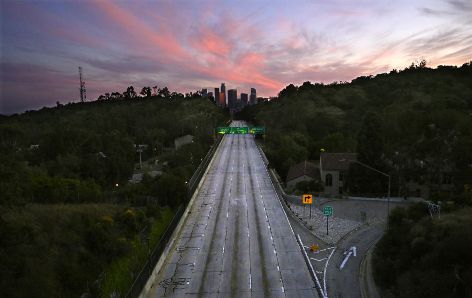 Empty lanes of the 110 Arroyo Seco Parkway lead to downtown Los Angeles on Sunday, April 26, 2020, during the coronavirus outbreak. (AP Photo/Mark J. Terrill)