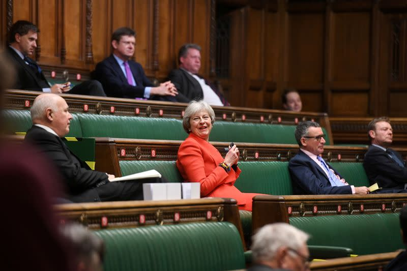 Britain's former Prime Minister Theresa May reacts during a debate at the House of Commons in London