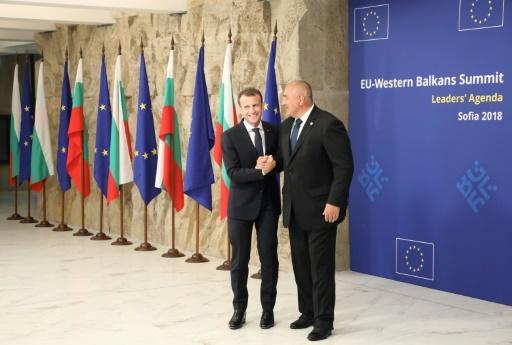 Bulgarian Prime Minister Boyko Borisov welcomes French President Emmanuel Macron on his arrival for an EU-Western Balkans summit in Sofia on May 17, 2018