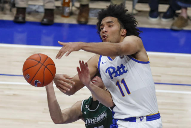 Pittsburgh's Justin Champagnie (11) tries to catch a pass as Binghamton's Dan Petcash defends during the second half of an NCAA college basketball game Friday, Dec. 20, 2019, in Pittsburgh. Pittsburgh won 79-53. (AP Photo/Keith Srakocic)