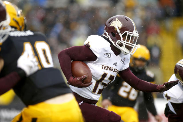 Texas State wide receiver Trevis Graham Jr. (13) runs the ball during the first half of an NCAA college football game against Appalachian State Saturday, Nov. 23, 2019, in Boone, N.C. (AP Photo/Brian Blanco)
