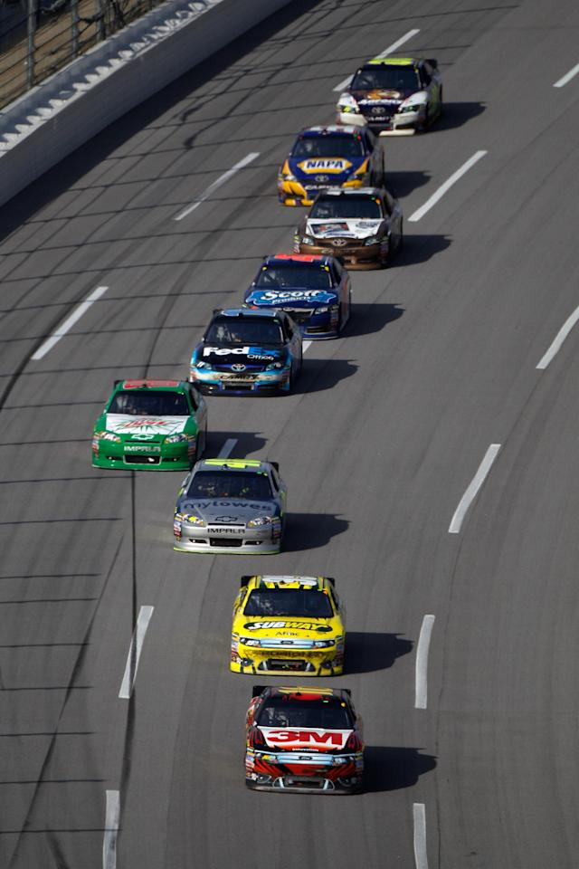 TALLADEGA, AL - OCTOBER 23: Greg Biffle, driver of the #16 3M/O'Reilly Auto Parts Ford, leads a line of cars during the NASCAR Sprint Cup Series Good Sam Club 500 at Talladega Superspeedway on October 23, 2011 in Talladega, Alabama. (Photo by Chris Graythen/Getty Images)