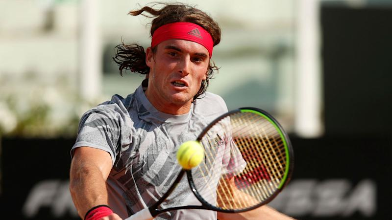 Tsitsipas back to winning ways on clay with victory over Evans in Hamburg