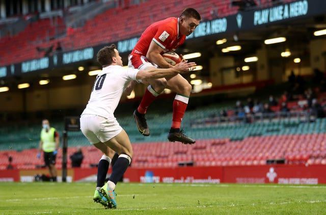 Josh Adams leaps high to catch Dan Biggar's kick for Wales' disputed first try