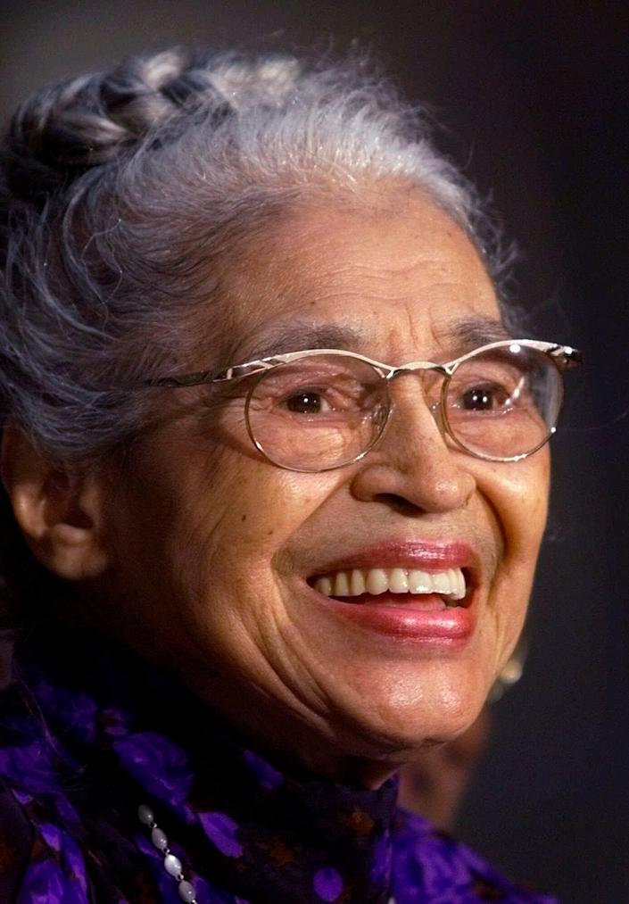 FILE -- In a June 15, 1999 file photo Rosa Parks smiles during a Capitol Hill ceremony where Parks was honored with the Congressional Gold Medal in Washington. A new statue of civil rights pioneer Rosa Parks will be unveiled in downtown Montgomery, Ala., on Sunday, Dec. 1, 2019. (AP Photo/Khue Bui, File)