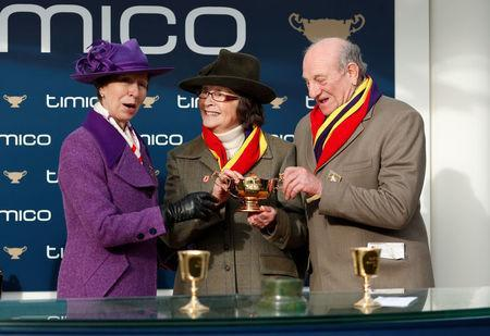 Horse Racing - Cheltenham Festival - Cheltenham Racecourse, Cheltenham, Britain - March 16, 2018 Owners Garth and Anne Broom pose with Princess Anne and the trophy after Richard Johnson rode Native River to victory in the 15.30 Timico Cheltenham Gold Cup Chase Action Images via Reuters/Andrew Boyers