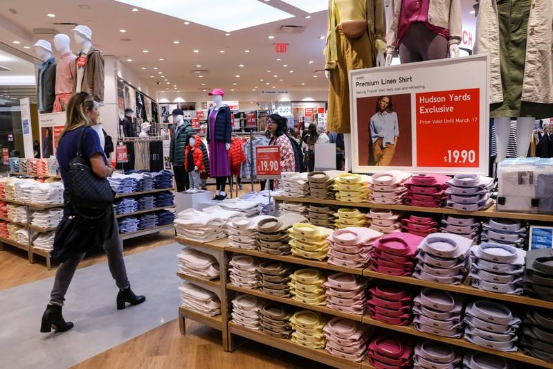 FILE PHOTO: People shop at an H&M store during the grand opening of the The Hudson Yards development in New York