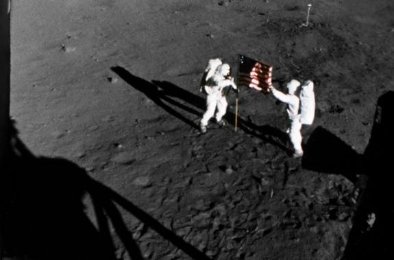 NASA astronauts Buzz Aldrin and Neil Armstrong raise the American flag on the moon during their July 20-21, 1969 moonwalk during the historic Apollo 11 lunar landing mission.