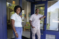 """Jamila and Akino West, owners of the Copper Door Bed & Breakfast, pose for a photograph, Wednesday, May 26, 2021, in the Overtown neighborhood of Miami. West renovated the once boarded-up 1940's-era Demetree Hotel in Overtown to create the Copper Door Bed & Breakfast, along with Rosie's restaurant. The couple is proud to be part of the neighborhood's revitalization, Jamila West said, adding that it's important to pay homage to the history, but to """"also insure that the current residents, or past residents even, have the same opportunity."""" (AP Photo/Lynne Sladky)"""