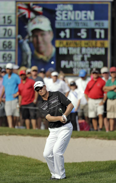 John Senden, of Australia, chips in on the 16th hole during the final round of the Valspar Championship golf tournament at Innisbrook, Sunday, March 16, 2014, in Palm Harbor, Fla. Senden went on to win the tournament. (AP Photo/Chris O'Meara)