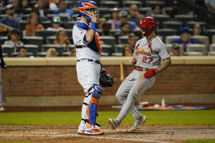 New York Mets catcher Tomas Nido looks to the infield as St. Louis Cardinals' Tyler O'Neill, right, scores on a sacrifice fly by Dylan Carlson during the fourth inning of a baseball game Tuesday, Sept. 14, 2021, in New York. (AP Photo/Frank Franklin II)