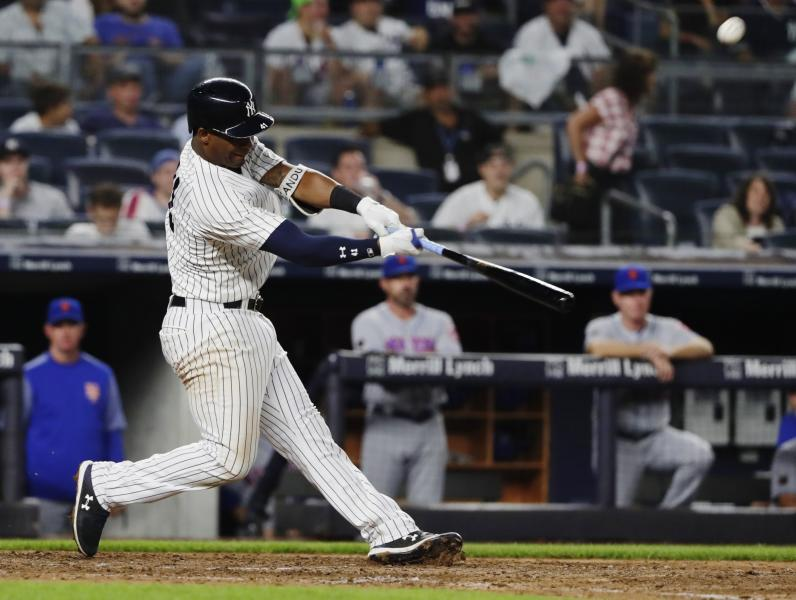 New York Yankees' Miguel Andujar hits a two-run home run during the eighth inning of a baseball game against the New York Mets Monday, Aug. 13, 2018, in New York. (AP Photo/Frank Franklin II)