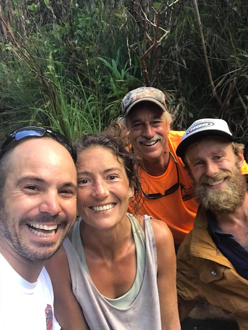In this image courtesy of Javier Cantellops and obtained at facebook.com/AmandaEllersMissing/, shows missing hiker Amanda Eller (2nd L) with her rescuers, (L-R) Javier Cantellops, Troy Helmer and Chris Berquist, on May 24, 2019, at Makawao Forest Reserve on the Hawaiian Island of Maui.