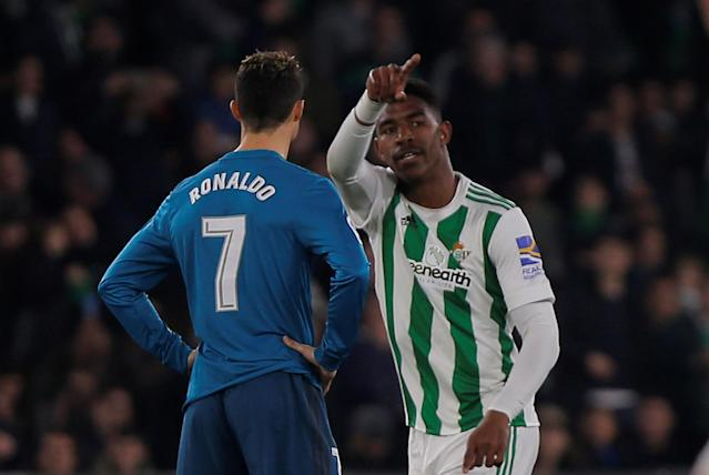 Soccer Football - La Liga Santander - Real Betis vs Real Madrid - Estadio Benito Villamarin, Seville, Spain - February 18, 2018 Real Betis' Junior Firpo celebrates after Real Madrid's Nacho scores an own goal and the second for Real Betis as Cristiano Ronaldo looks on dejected REUTERS/Jon Nazca