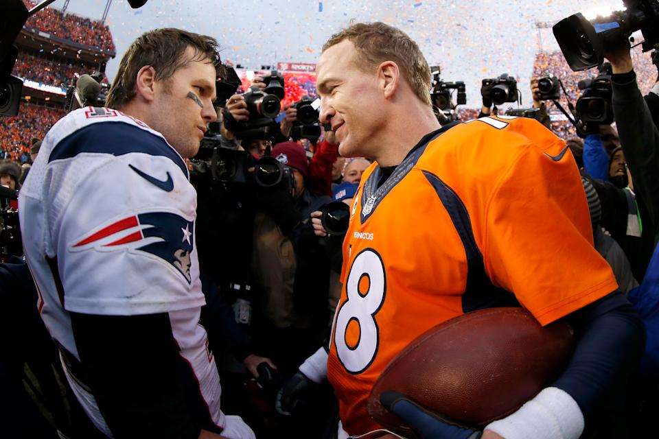 Peyton Manning of the Denver Broncos and Tom Brady of the New England Patriots speak after the AFC championship game on Jan. 24, 2016. (Ezra Shaw/Getty Images)