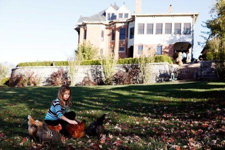 Dr. Cindy Brownfield's 11-year-old daughter Emma plays with her chickens in her backyard in the Museum Hill Historic District in St. Joseph, Missouri, U.S. November 15, 2016. REUTERS/Whitney Curtis