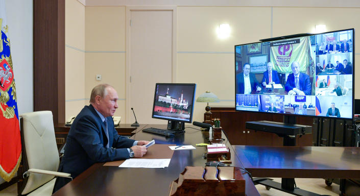 Russian President Vladimir Putin participates in a meeting with the leaders of the political parties via video conference at the Novo-Ogaryovo residence outside Moscow, Russia, Saturday, Sept. 25, 2021. (Alexei Druzhinin, Sputnik, Kremlin Pool Photo via AP)