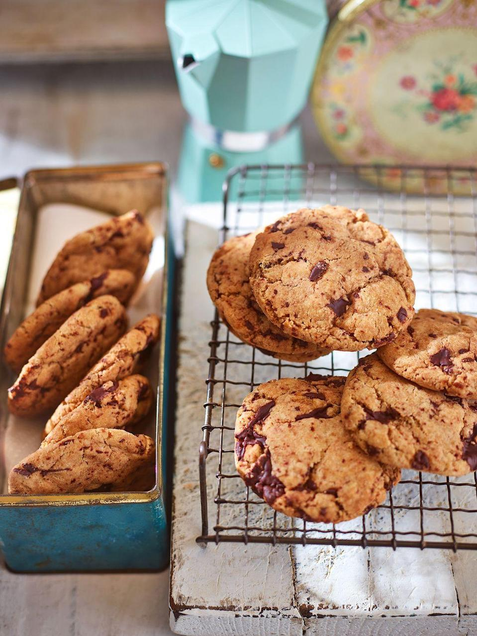 """<p>These vegan chocolate chip cookies are so moreish, even non-vegans will be coming back for a second serving!</p><p><strong>Recipe: <a href=""""https://www.goodhousekeeping.com/uk/food/recipes/a25542611/vegan-cookies/"""" rel=""""nofollow noopener"""" target=""""_blank"""" data-ylk=""""slk:Vegan chocolate chip cookies"""" class=""""link rapid-noclick-resp"""">Vegan chocolate chip cookies</a></strong></p>"""