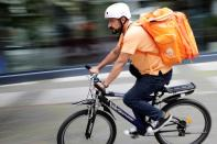 Former Afghan Communication Minister Sadaat works as a bicycle rider for the food delivery service Lieferando in Leipzig