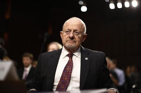 U.S. Director of National Intelligence Clapper reacts as he testifies at Senate Intelligence Committee hearing the Foreign Intelligence Surveillance Act legislation on Capitol Hill in Washington