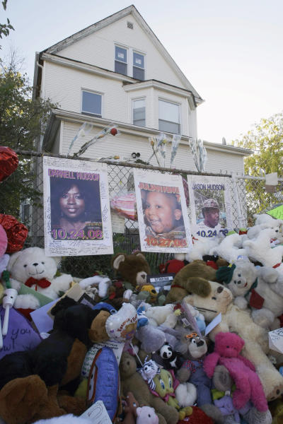 FILE - In an Oct. 28, 2008 file photo, a makeshift memorial for three family members of actress and singer Jennifer Hudson is seen outside Darnell Donerson's home in Chicago. Hudson's mother and brother Jason Hudson were found murdered in the house. A nephew, Julian King, was found shot to death in an SUV on the city's West Side. On Monday, April 23, 2012, opening statements begin in Chicago for William Balfour, charged in the killings. (AP Photo/Charles Rex Arbogast, File)