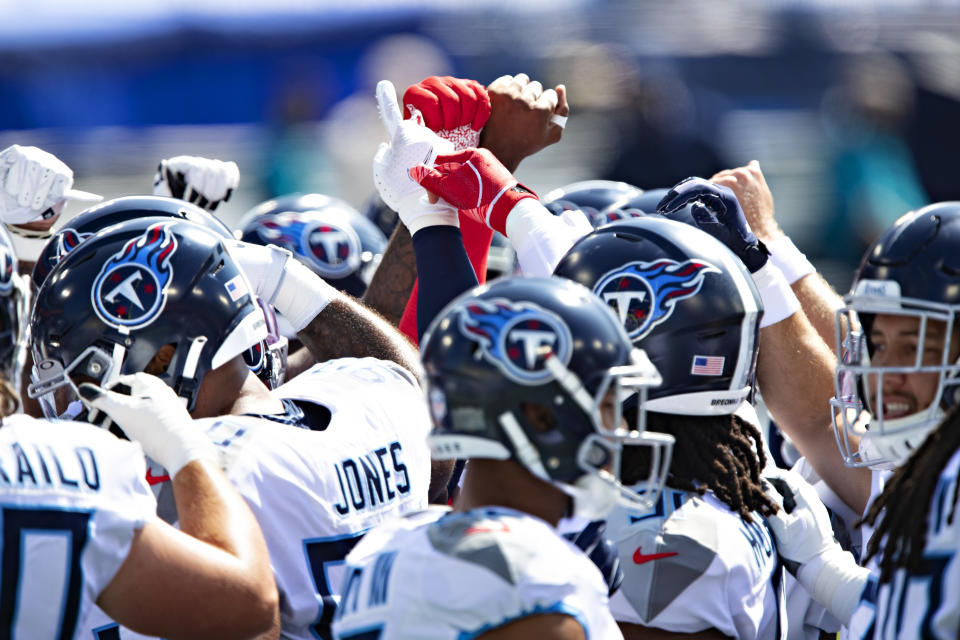 NASHVILLE, TN - SEPTEMBER 20:  Players of the Tennessee Titans huddle together before a game against the Jacksonville Jaguars at Nissan Stadium on September 20, 2020 in Nashville, Tennessee. The Titans defeated the Jaguars 33-30.  (Photo by Wesley Hitt/Getty Images)