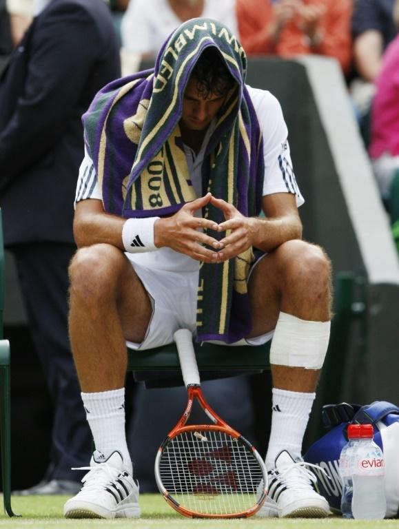 Shock triumph: Mario Ancic sits on his chair after his 2002 win over Federer