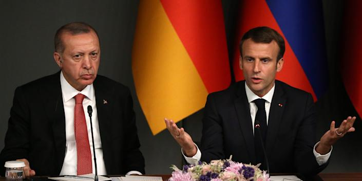 ISTANBUL, TURKEY - OCTOBER 27: (RUSSIA OUT) Turkish President Recep Tayyip Erdogan (L) and French President Emmanuel Macron (R) attend their joint press conference at the Summit on October 27, 2018 in Istanbul, Turkey. Leaders of Germany, France, Russia and Turkey have gathered in Istanbul for a one-day summit on Syrian crisis. (Photo by Mikhail Svetlov/Getty Images)