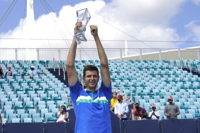 Hubert Hurkacz of Poland poses with the trophy after defeating Yannik Sinner of Italy during the finals of the Miami Open tennis tournament, Sunday, April 4, 2021, in Miami Gardens, Fla. Hurkacz won 7-6 (4), 6-4. (AP Photo/Lynne Sladky)