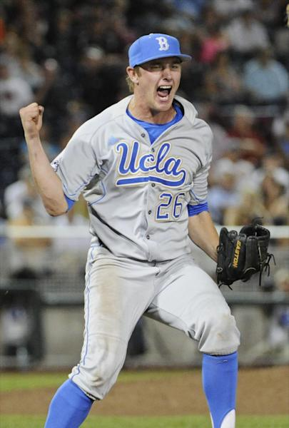 UCLA closing pitcher David Berg reacts after the final out against Mississippi State in the ninth inning of Game 1 of the NCAA College World Series baseball best-of-three finals, Monday, June 24, 2013, in Omaha, Neb. UCLA won 3-1. (AP Photo/Francis Gardler)