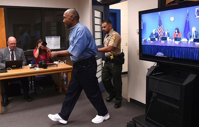 <p>Former NFL football star O.J. Simpson enters for his parole hearing at the Lovelock Correctional Center in Lovelock, Nev., on Thursday, July 20, 2017. Simpson was convicted in 2008 of enlisting some men he barely knew, including two who had guns, to retrieve from two sports collectibles sellers some items that Simpson said were stolen from him a decade earlier. (Jason Bean/The Reno Gazette-Journal via AP, Pool) </p>