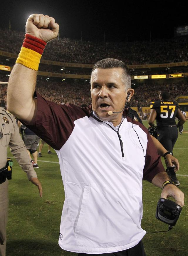 Arizona State head coach Todd Graham celebrates a win against Wisconsin after an NCAA college football game on Saturday, Sept. 14, 2013, in Phoenix. Arizona State defeated Wisconsin 32-30. (AP Photo/Ross D. Franklin)