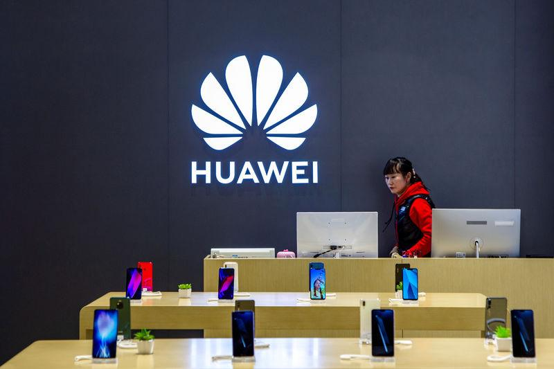 Staff member is seen inside a Huawei retail store in Shanghai