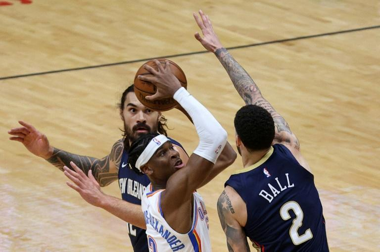 Oklahoma City's Shai Gilgeous-Alexander shoots over New Orleans' Lonzo Ball in the Thunder's NBA win over the Pelicans