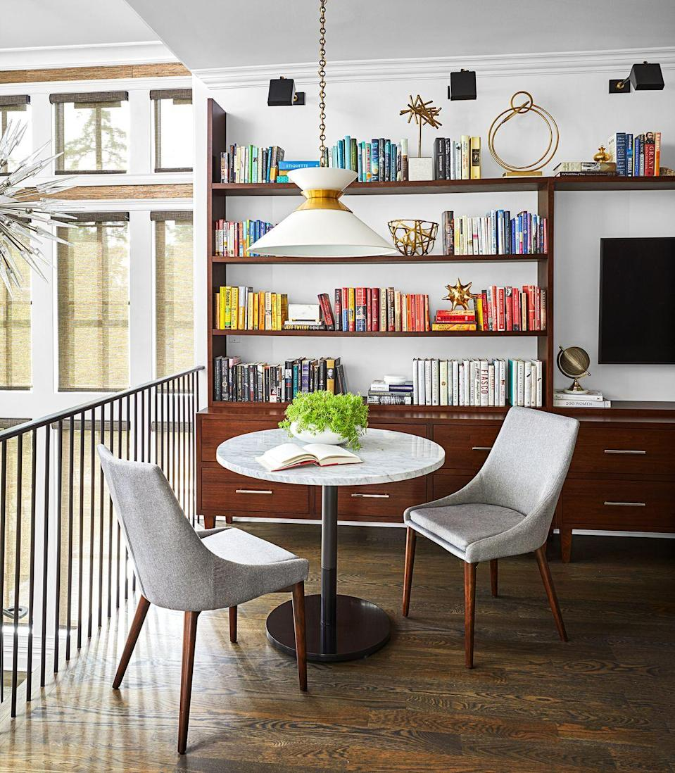 """<p><a href=""""https://coreydamenjenkins.com/"""" rel=""""nofollow noopener"""" target=""""_blank"""" data-ylk=""""slk:Corey Damen Jenkins"""" class=""""link rapid-noclick-resp"""">Corey Damen Jenkins</a> put this foyer loft to work by turning it into a useable alcove instead of wasted space. The shelves are lined with plenty of books for a small-scale library feel, and the low-hanging pendant adds task lighting for a small study area. </p>"""