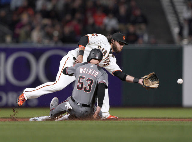 Arizona Diamondbacks' Christian Walker (53) slides safely into second base with a steal as San Francisco Giants shortstop Brandon Crawford reaches for the throw during the seventh inning of a baseball game in San Francisco, Tuesday, Aug. 27, 2019. (AP Photo/Tony Avelar)