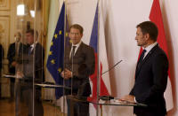 Prime Minister of Czech Republic Andrej Babis, Austrian Chancellor Sebastian Kurz and Slovakia's Prime Minister Igor Matovic, from left, behind plexiglass shields address the media during a press conference as part of a meeting at the federal chancellery in Vienna, Austria, Wednesday, Sept. 9, 2020. (AP Photo/Ronald Zak)