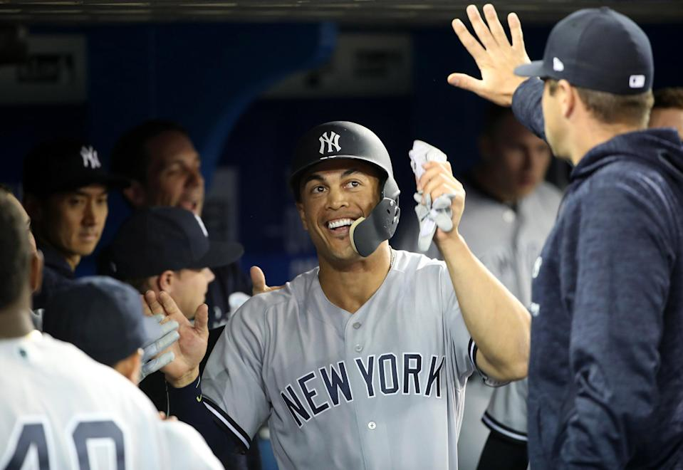 Giancarlo Stanton's debut was everything Yankees fans could have hoped for. (Tom Szczerbowski/Getty Images)