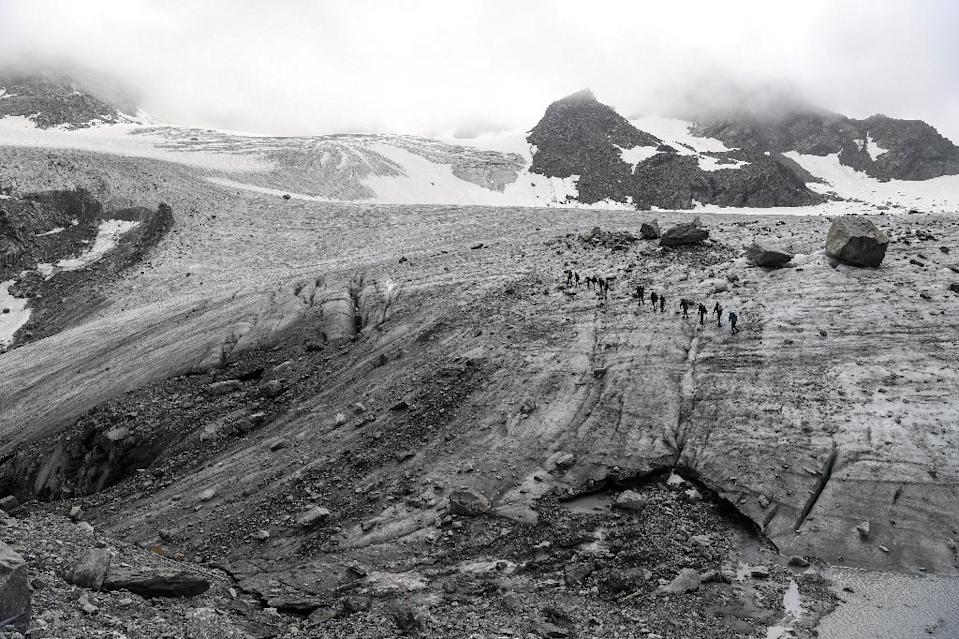 The team found manmade radioactive material in all 17 glaciers sites they surveyed (AFP Photo/PHILIPPE DESMAZES)