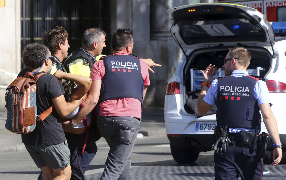 <p>An injured person is carried in Barcelona, Spain, Aug. 17, 2017, after a white van jumped the sidewalk in the historic Las Ramblas district, crashing into a summer crowd of residents and tourists and injuring several people, police said. (Oriol Duran/AP) </p>