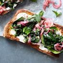 """<p>Nutrient-rich greens and onions make this toast shine, but favorites like lemon juice, feta, and Greek yogurt on top of whole-grain toast keep it grounded (and super-satisfying).</p><p><a href=""""https://www.prevention.com/food-nutrition/recipes/a33983845/sauteed-dandelion-toast-recipe/"""" rel=""""nofollow noopener"""" target=""""_blank"""" data-ylk=""""slk:Get the recipe from Prevention »"""" class=""""link rapid-noclick-resp""""><strong><em>Get the recipe from Prevention »</em></strong></a></p>"""