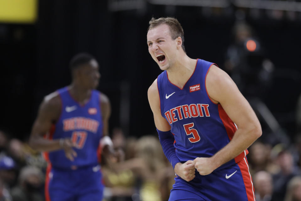 Detroit Pistons' Luke Kennard reacts after hitting a shot during the second half of the team's NBA basketball game against the Indiana Pacers, Wednesday, Oct. 23, 2019, in Indianapolis. Detroit won 119-110. (AP Photo/Darron Cummings)
