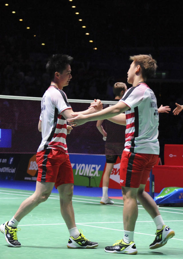 Indonesia's Marcus Fernaldi Gideon and Kevin Sanjaya Sukamuljo, left, celebrate after defeating Denmark's Mathias Boe and Carsten Mogensen in the men's doubles final match at the All England Open Badminton tournament in Birmingham, England, Sunday March 18, 2018. (AP Photo/Rui Vieira)