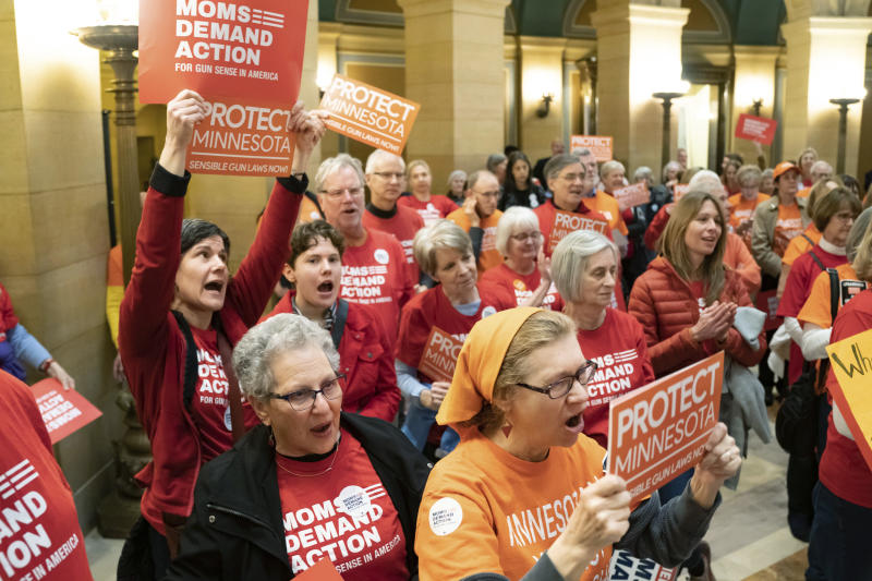 Members of Moms Demand Action rally in the Minnesota state Capitol Rotunda in St. Paul on April 29, 2019.
