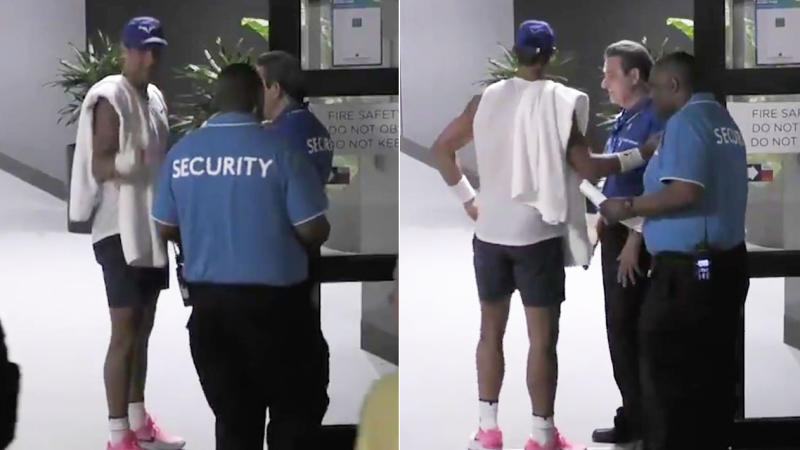 Rafael Nadal smiles as he is stopped by security at the Australian Open.
